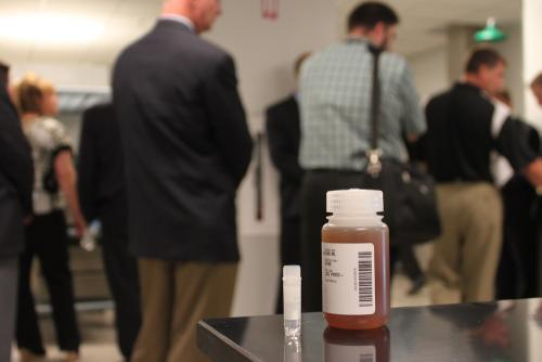 A vial of ethanol enzyme is displayed during the grand opening of the Novozymes laboratory in Blair, Neb.