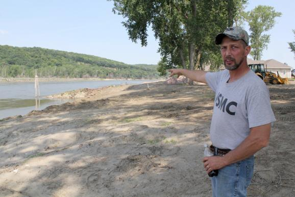Bill Smith, president of the Missouri Valley Waterfowlers Association, stands near homes built along the Missouri River. Smith is also a subcontractor and has worked on dozens of homes since last year's flood.