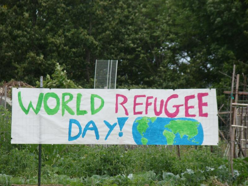 A sign welcomes people from all over the world to Columbia's World Refugee Day celebration.