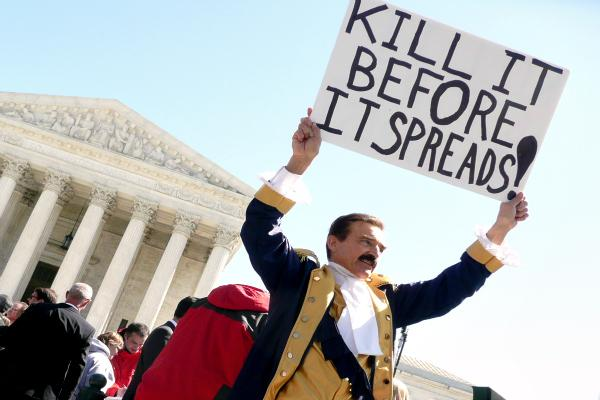 Protesters outside the U.S. Supreme Court, during the court's oral arguments in March.
