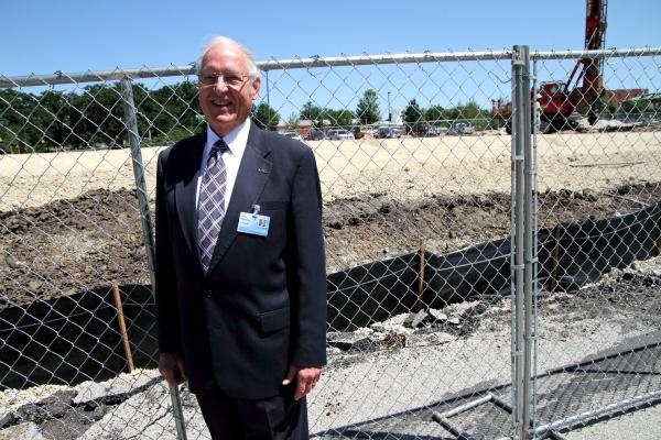 Jack Magruder, president of A.T. Still University, standing in front of the future school of dentistry in Kirksville.