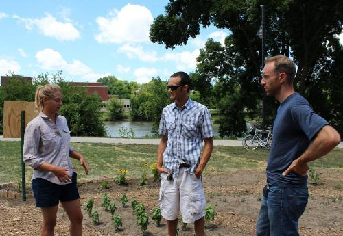 Carolyn Scherf, a farmhand from the Iowa City-area; Troy Washam, co-owner of a small farm near DeWitt, Iowa; and Grant Schultz, co-director of Farm Hack Iowa, stand in the University of Iowa Garden at the conclusion of the first Midwestern Farm Hack.