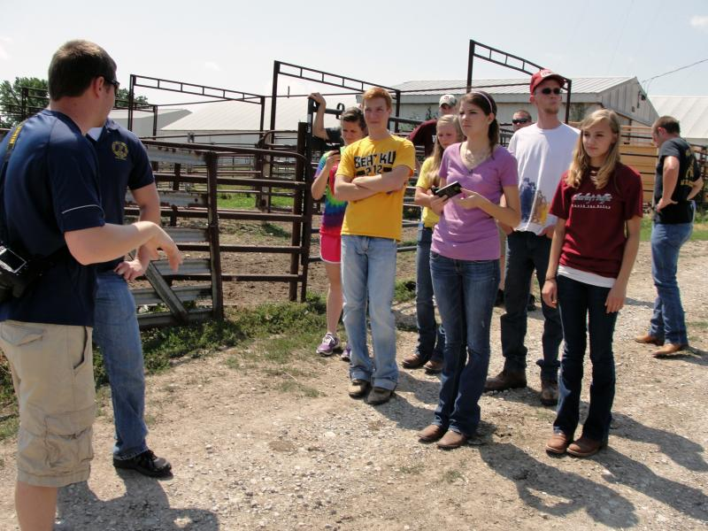 Research assistant, Brad Scharf (left), gives the 4h youths a tour of MU's South Farm.