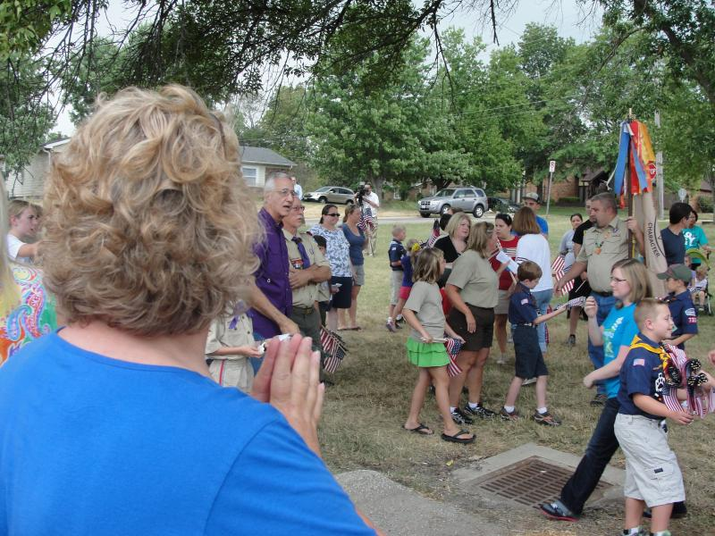 Volunteers gathered at Shepard Boulevard Elementary before splitting into four teams to cover all the ground along the nearly 1-mile route on Friday July 13, 2012