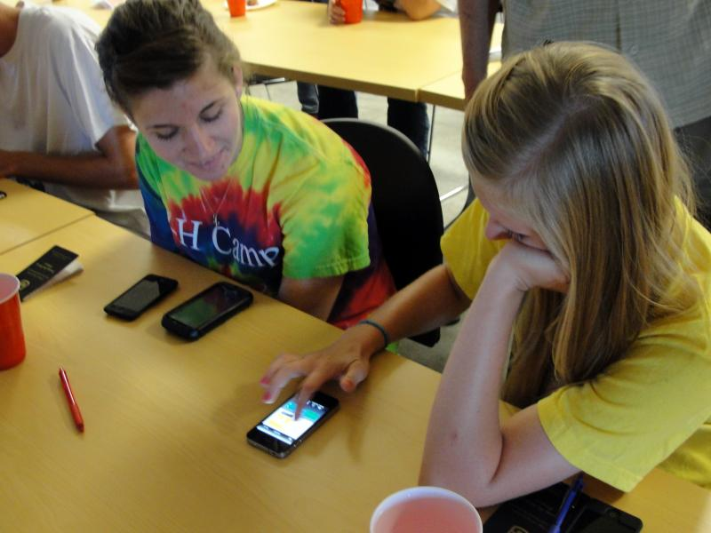 Jessie Fowler (left) and Kendra Stinson test Thermal Aid on an iPhone.