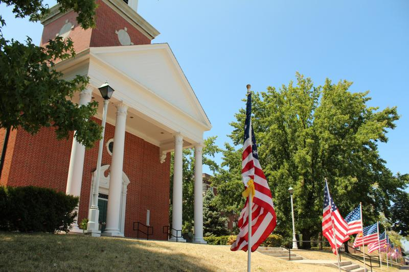 American flags line the sidewalk around First Baptist Church in downtown Columbia in preparation for the funeral Saturday of Spc. Sterling Wyatt, who was killed in Afghanistan earlier this month.