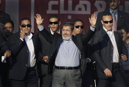 Newly-elected Egyptian President Mohammed Morsi waves to guests after giving an inaugural address at Cairo University in Cairo, Egypt.
