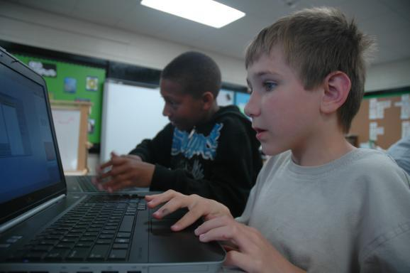Students work on their computers in the video game club at Benton Elementary in Columbia, MO