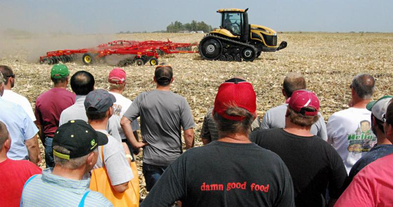 An emcee gave visitors information about each combine that cut corn and churned up the ground at fields beside the show grounds.