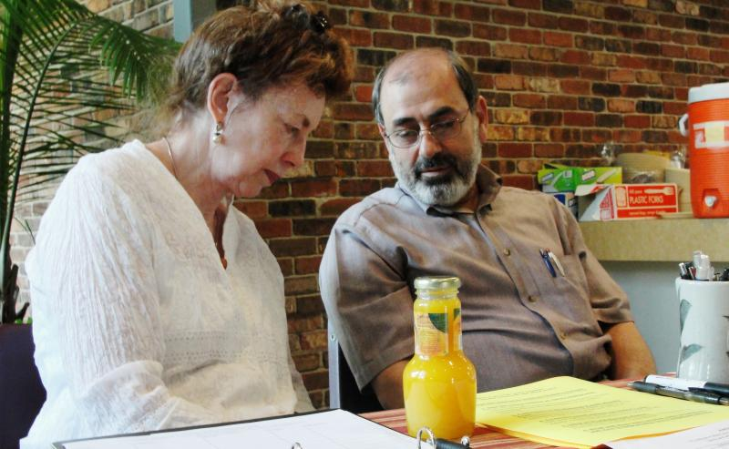 Cathy Salter talks to Shakir Hamoodi before eating dinner at a celebration and farewell event for Hamoodi on Wednesday August 22, 2012. Hamoodi was sentenced to three years in federal prison for sending money to Iraq during U.S. trade sanctions.