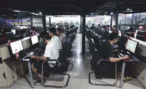 Chinese Netizens are seen at an Internet cafe in Beijing, China.