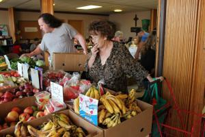 Margo Rush goes to FoodNet in the basement of the Lakeview Methodist Church in Lincoln, Neb., to make her budget and SNAP benefits last through the month.