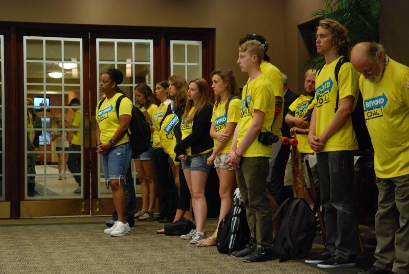 Coal Free Mizzou demonstrators wait to present 3,000 student signatures to the University of Missouri Board of Curators during a meeting on Sept. 13 in Columbia. Chancellor Brady Deaton accepted the petition and agreed to meet with the group later.