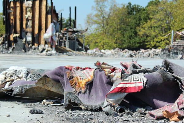 Remnants of prayer rugs lie amid the rubble of what used to be a mosque in Joplin. The mosque burned down on Aug. 6. The fire is still under investigation.