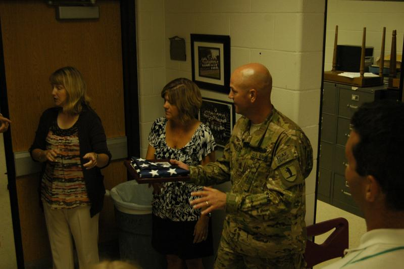 Sergeant Major Mike Lederle and his wife Kena planned a surprise for their children at their school in Ashland Wednesday, September 12th. Mike waited outside the gymnasium as his kids took part in a flag presentation ceremony.