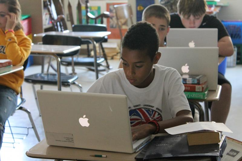 Students in New Franklin, MO. use technology to complete a research project on Wednesday, September 19. The eMINTS approach stresses learning with technology, so students have access to laptops and iPads.