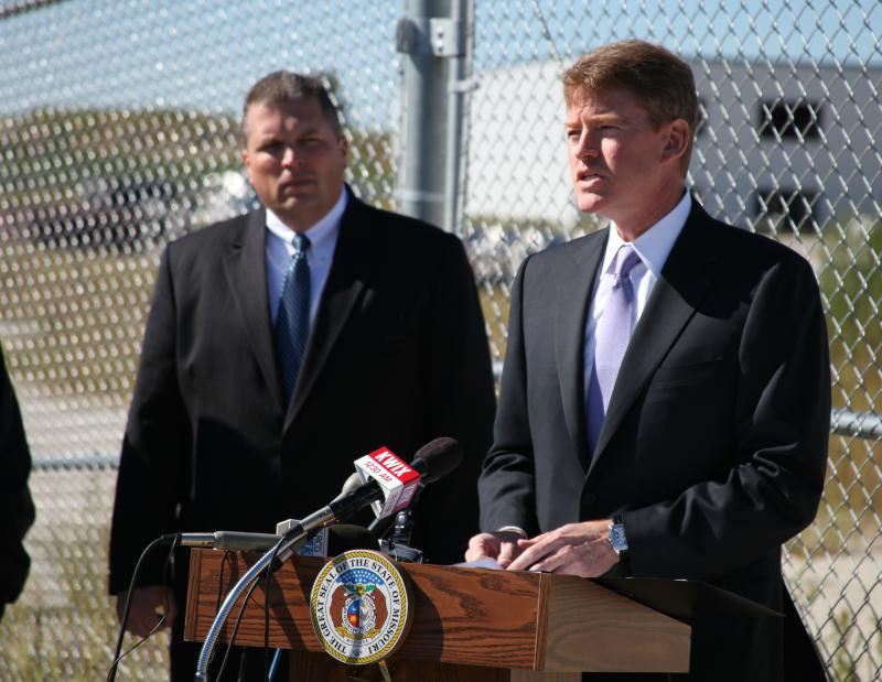 With the old Mamtek site in Moberly, Mo., as a backdrop, Attorney General Chris Koster announced that Mamtek CEO Bruce Cole was arrested this morning in California.