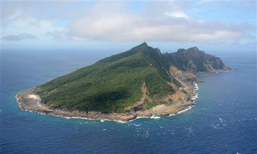 This June 2011 file photo shows Uotsuri Island, one of the islands of Senkaku in Japanese and Diaoyu in Chinese, in the East China Sea.