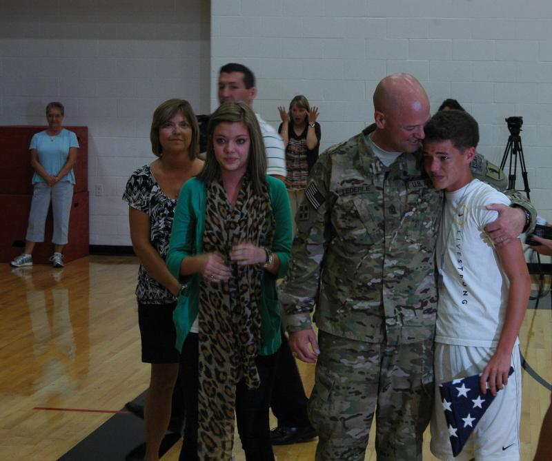 Sergeant Major Mike Lederle and his wife Kena planned a surprise for their children at their school in Ashland Wednesday, September 12th. His 9th and 11th graders, Trinten and Samantha, thought Mike was still on deployment to Afghanistan.