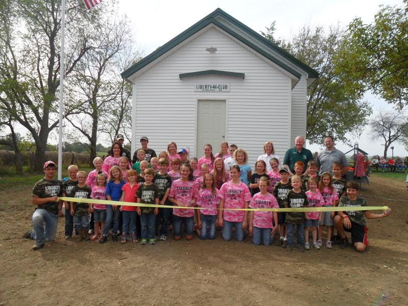 Chillicothe, Missouri's Liberty 4-H club, posed in front of the restored Swain Schoohouse, Saturday, Sept. 29.
