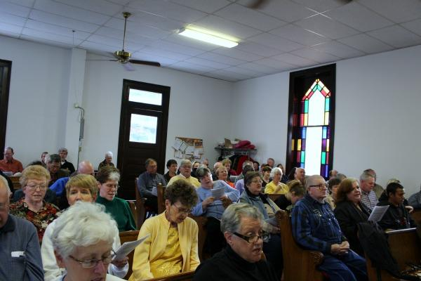 Congregants gather inside First Christian Church in Rocheport for the monthly bluegrass service.