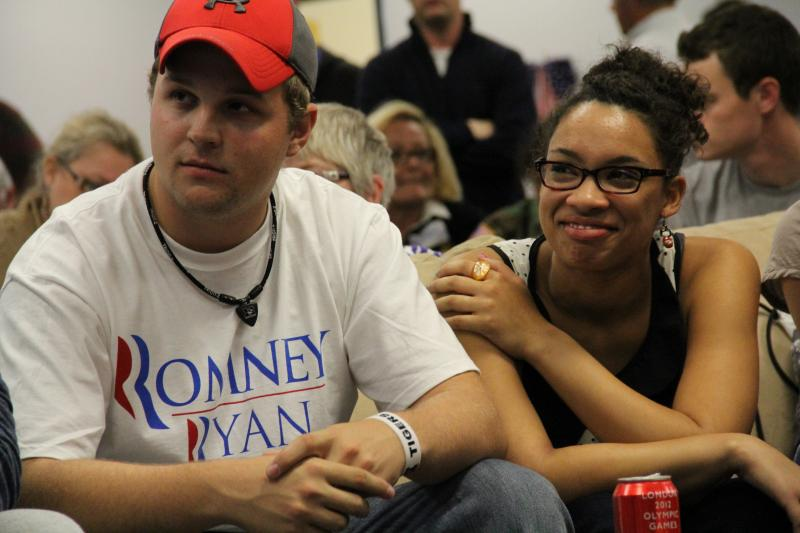 John Soper, left, and Destiny Albritton watch the presidential debate at Boone County Republican offices, Wednesday, Oct. 3.