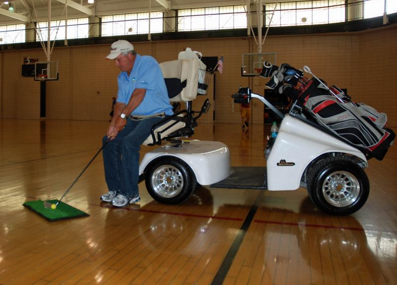 Dany Baker demonstrates golfing from his accessible golf cart on Monday, Oct. 1, 2012, at the MU Student Recreation Complex in Columbia, Mo. Baker co-hosted the adaptive golf presentation as part of Ability Week 2012.