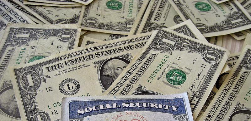 Social Security card on top of money.