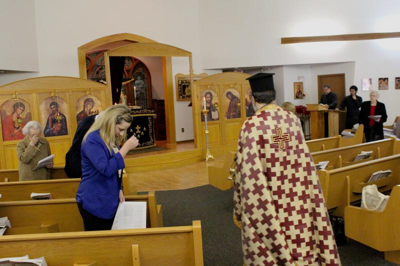 Worshipers make the sign of the cross as Father Michael Monos passes by at St. Luke's the Evangelist Greek Orthodox Church in Columbia. The Orthodox Church is the second largest Christian community in the world.