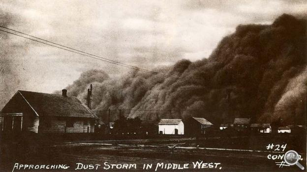 A dust cloud rises over an unspecified town on the southern Plains.
