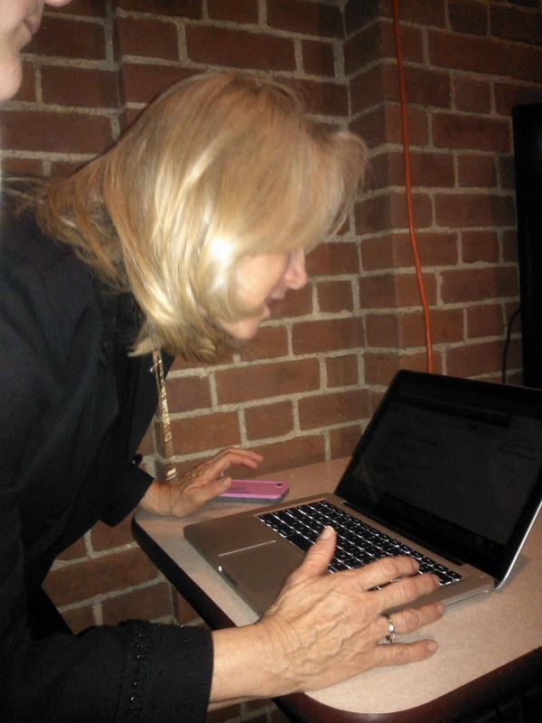 State Representative candidate Jeanie Riddle checks election results on her laptop