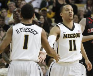 Michael Dixon (11) with teammate Phil Pressey in a game last season.