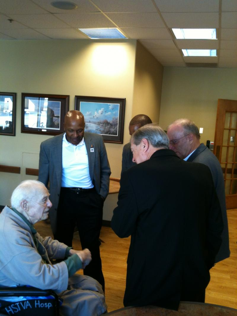 Some members of the Pinnacle Five meet with a veteran at the Truman VA Hospital (left to right: Alford McMichael, Vincent Patton, Jack Tilley, James Herdt).