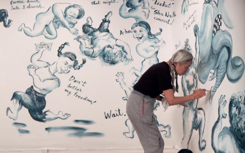 Noriko Shinohara working on a painting. From Zachary Heinzerling's CUTIE AND THE BOXER, a documentary about the 40-year marriage of artists Ushio and Noriko Shinohara.