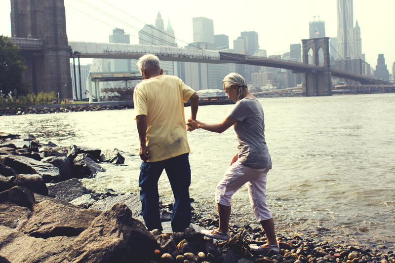 Ushio (l.) and Noriko Shinohara walking along the Brooklyn Bridge. From Zachary Heinzerling's CUTIE AND THE BOXER, a documentary about the 40-year marriage of artists Ushio and Noriko Shinohara.