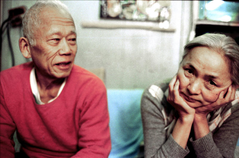 Ushio (l.) and Noriko Shinohara in their Brooklyn, NY home. From Zachary Heinzerling's CUTIE AND THE BOXER, a documentary about the 40-year marriage of artists Ushio and Noriko Shinohara.