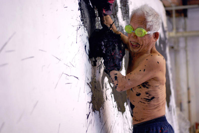 Ushio Shinohara working on a boxing painting. From Zachary Heinzerling's CUTIE AND THE BOXER, a documentary about the 40-year marriage of artists Ushio and Noriko Shinohara.