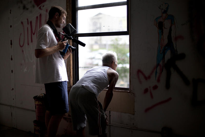Director Zachary Heinzerling films Ushio Shinohara. From Zachary Heinzerling's CUTIE AND THE BOXER, a documentary about the 40-year marriage of artists Ushio and Noriko Shinohara.
