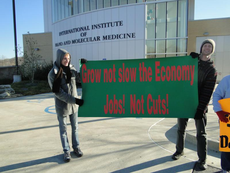 Demonstrators gather outside the International Institute of Nano and Molecular Medicine to protest a series of budget cuts known as sequestration.