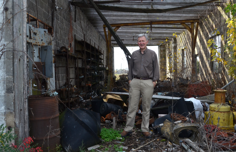 MU Professor Brian Dabson stands in a tattered workshop of the defunct Joe Gilliam Mining Company, which used to mine clay, in Goss, Mo. The town now has zero residents.