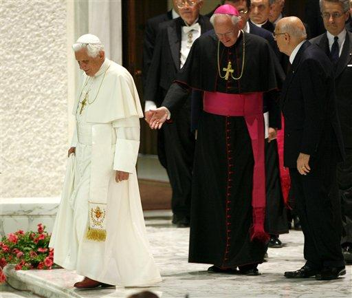 Pope Benedict XVI and Italian President Giorgio Napolitano arrive at the Paul VI Hall at the Vatican.
