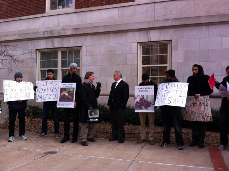 Jeff Stack of the Mid-Missouri Fellowship of Reconciliation addresses Daniel Clay, dean of the College of Eduation, who came outside to respond to the protest of the possible hire of former Guantanamo psychologist Larry James.