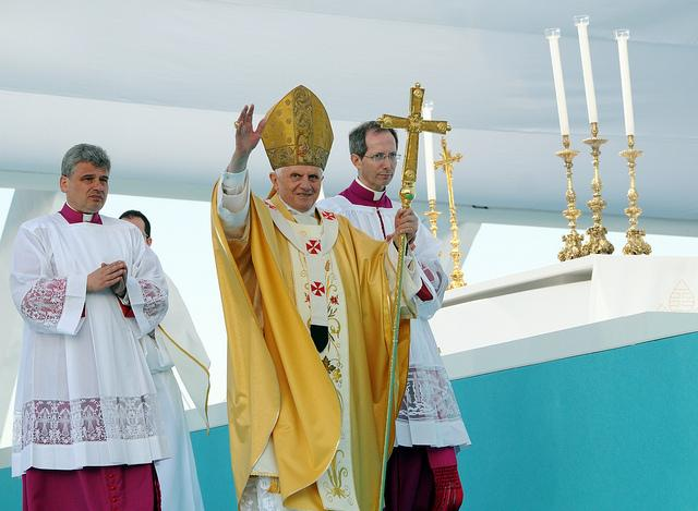 Pope Benedict XVI waves to the crowd as he arrives for an open-air mass in the Terreiro do Paso in Lisbon, on May 11, 2010.