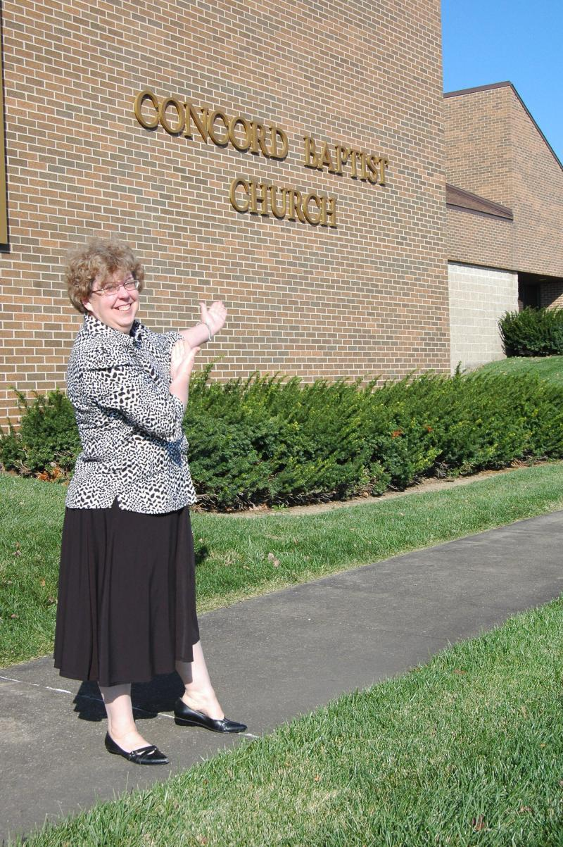 Debbie Lose-Kelly, a born again Christian, stands outside of Concord Baptist Church in Jefferson City on October 28, 2012.