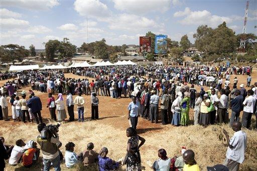 Voters wait in line at a polling station to cast their ballots in Nairobi, Kenya.