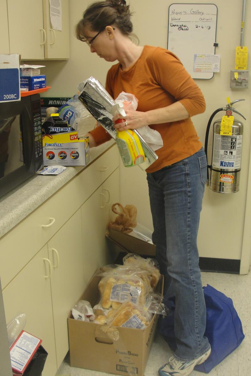 Meg Hegemann, the pastor at the Wilkes Boulevard United Methodist Church, organizes leftover supplies that will be distributed to Columbia agencies.