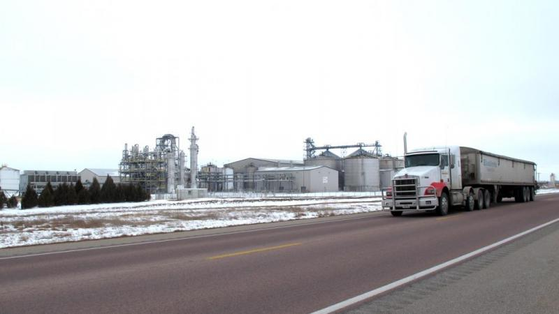 A semi rolls past NEDAK ethanol. The plant shut down when corn prices peaked during the summer of 2012 and new demand from E15 failed to materialize.
