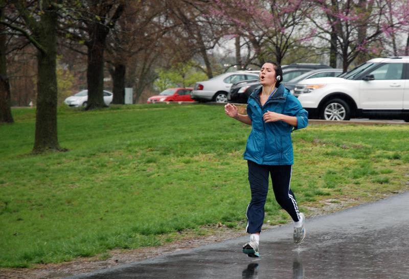 A runner sprints to the finish line at the 118th Boston Strong run in Columbia, Mo., on Saturday April 27, 2013. Despite the cold rain, over thirty people came out to participate in the event at Stephens Lake Park.