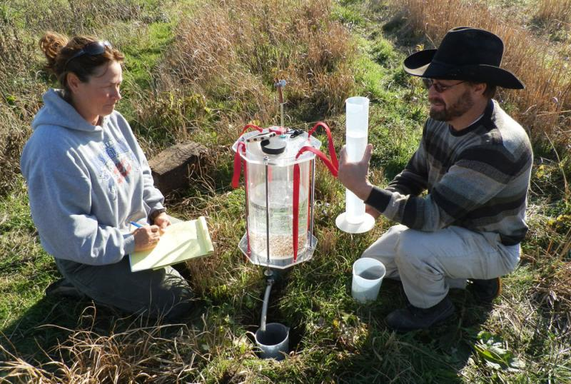 MU researchers measure soil water infiltration.