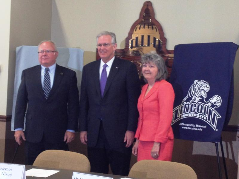 Governor Jay Nixon stands with Lincoln University President Dr. Connie Hamacher and Linn State Technical College President Dr. Don Claycomb on Wednesday, May 15, 2013.